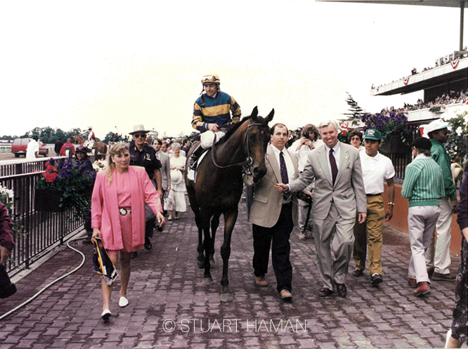 Owner/breeder Jim Ryan (right) and trainer David Donk proudly lead Awad into the winner's circle at Belmont Park following the Grade 1 Manhattan in 1995.