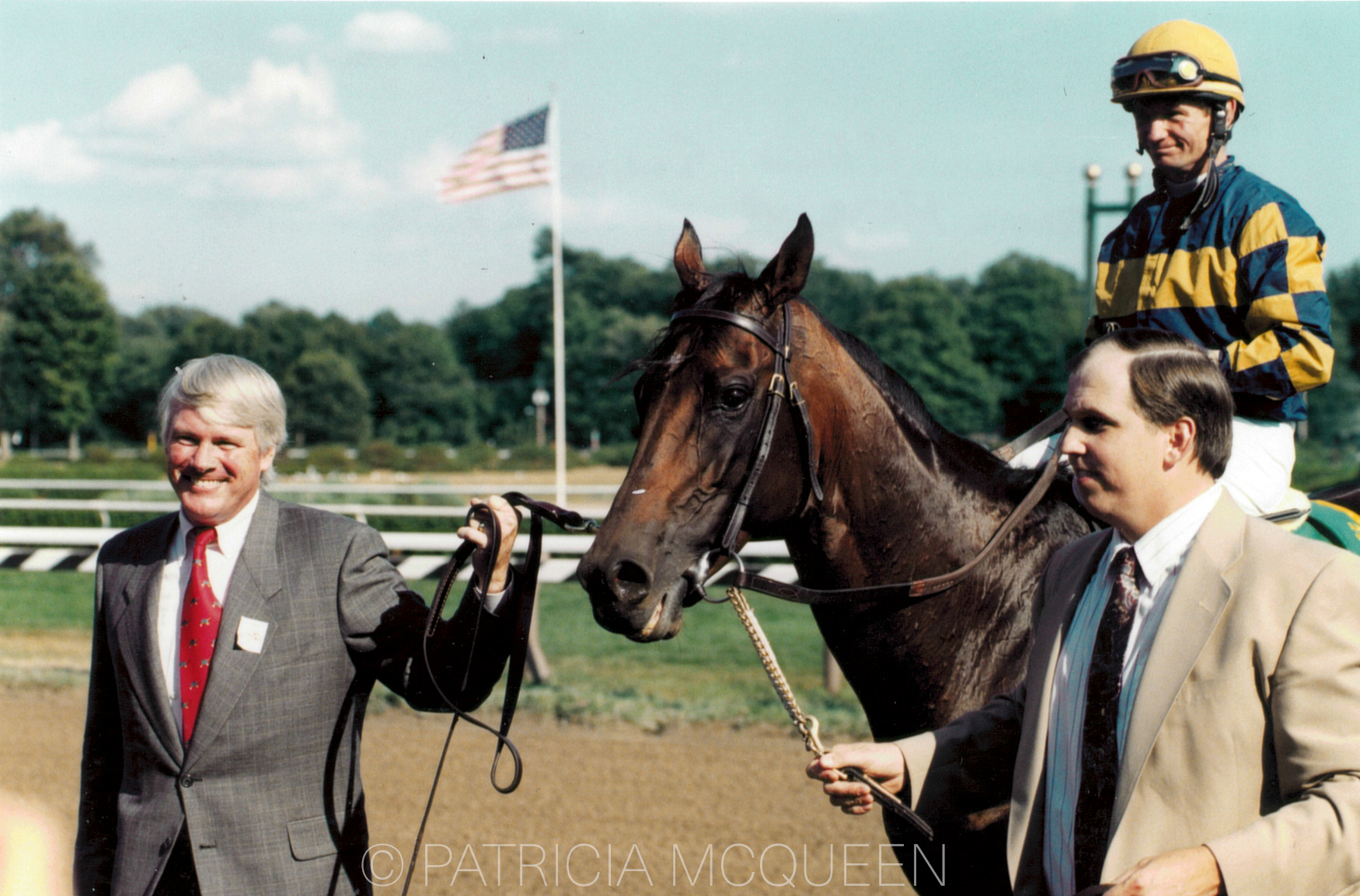 Co-owner Chris Everett (left) and trainer David Donk lead Awad and rider Pat Day into winner's circle following Awad's course record-breaking Sword Dancer in 1997.