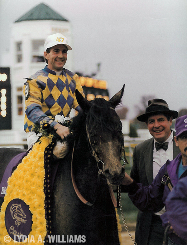 Draped by the Breeders' Cup Classic blanket, Concern and Jerry Bailey are led in by winning trainer Dickie Small and groom Pedro Mojarro.