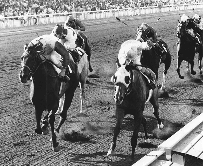 Twixt and rider Bill Passmore (left) take Hollywood Park's Milady Handicap in a thriller over Tallahto in 1974
