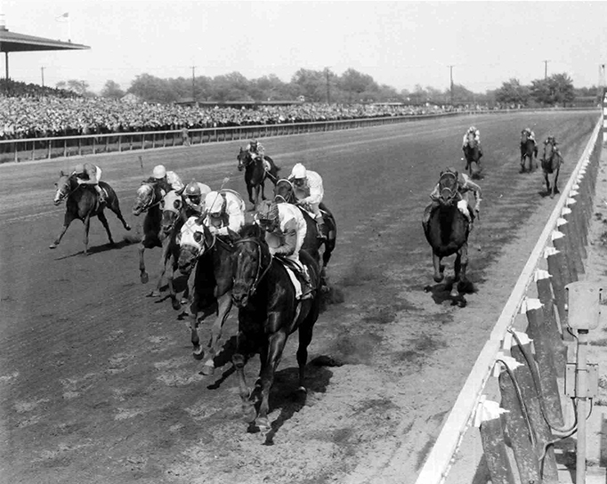 Carrying 130 pounds and giving from 11 to 24 pounds to the rest of the field, Vertex pulled away from Big Effort (112 pounds) to win the 1959 Grey Lag Handicap at Jamaica.  Bert and Morgan photo