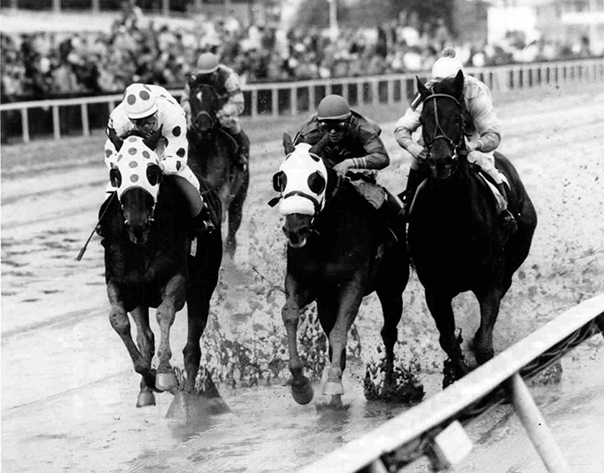 Early in the running of the 1987 John B. Campbell Handicap-G3 at Pimlico, Broad Brush (rail) kept close contact with Little Bold John (left) and Duxun Limited (center). He went on to win the mile and a quarter race by five lengths  (Double J Photo)