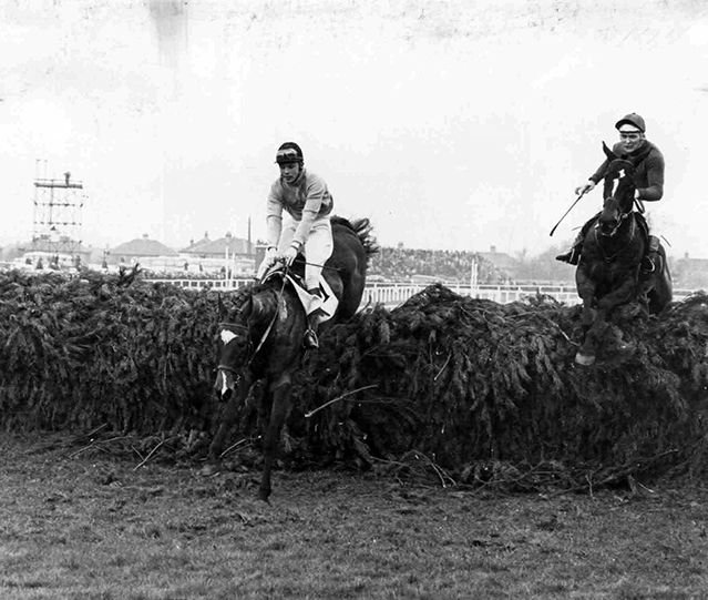 Final fence on way to victory in the Grand National at Aintree